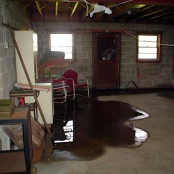 A flooded basement showing groundwater intrusion in Dover