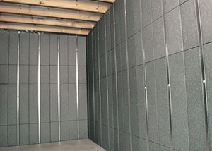 SilverGlo™ insulation and metal studs making up our Basement to Beautiful™ panels.  Installed in Highland Acres.