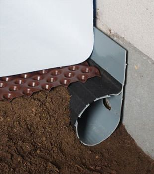 Closeup of a crawl space drainage system installed in Millsboro