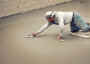 smoothing out the grout in a slab releveling project in Hockessin